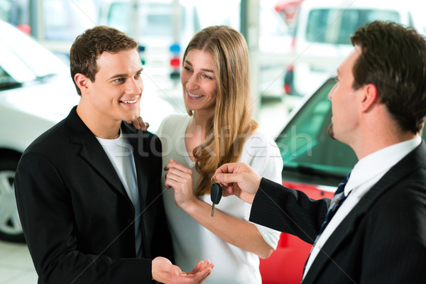 Car sales - key being given to couple Stock photo © Kzenon