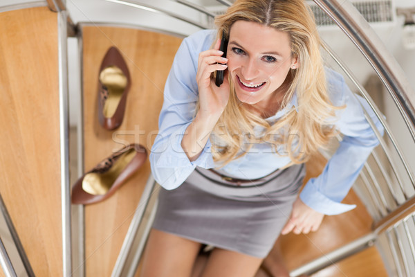 Businesswoman making a phone call at home Stock photo © Kzenon