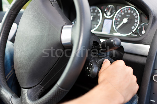 Man turning the ignition key of his car Stock photo © Kzenon