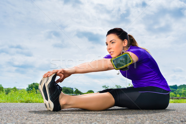 Sports outdoor - young woman doing fitness in park Stock photo © Kzenon