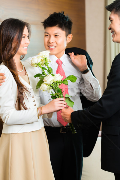Asian Chinese hotel manager welcome VIP guests Stock photo © Kzenon