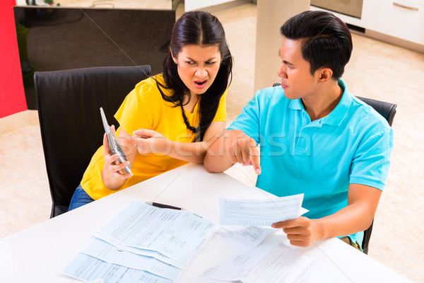 Asian couple fighting unpaid bills Stock photo © Kzenon
