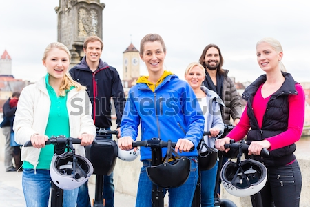 Tourists having Segway sightseeing Stock photo © Kzenon