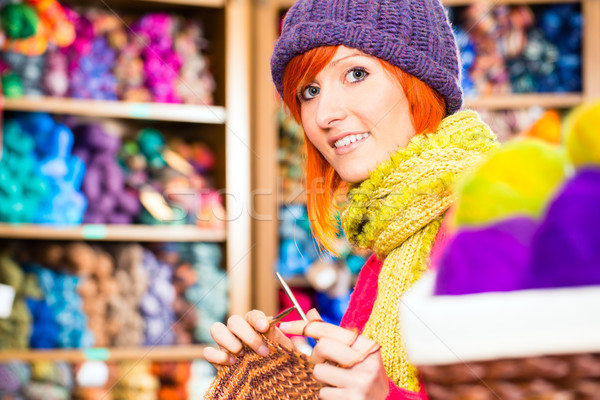 Young woman in knitting shop with circular needle Stock photo © Kzenon