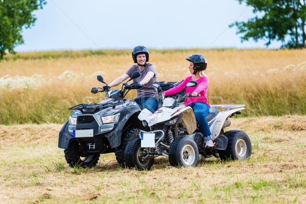 Couple driving off-road with quad bike or ATV Stock photo © Kzenon