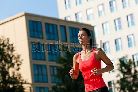 Girl taking walk in the city Stock photo © Kzenon