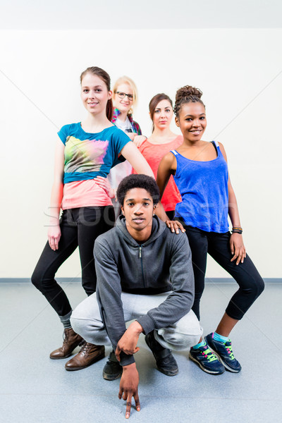 Young men and women in dance class posing Stock photo © Kzenon