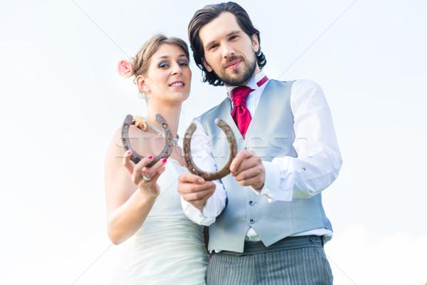 Esküvő pár mutat patkó szerencse menyasszony Stock fotó © Kzenon