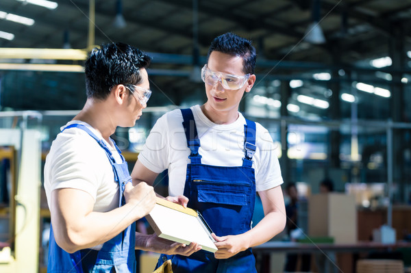 Carpenter team in Asian wood workshop  Stock photo © Kzenon