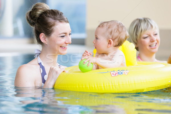 Mothers and kids having fun together playing with toys in pool Stock photo © Kzenon