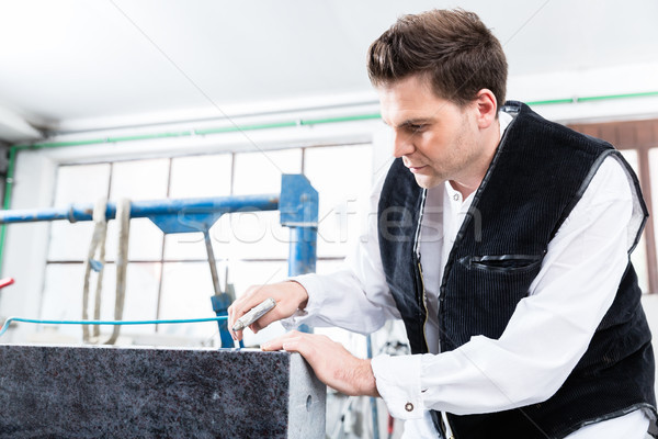 Stonemason working with compressed air at gravestone Stock photo © Kzenon