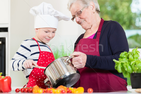 Granny cooking together with her grandson Stock photo © Kzenon