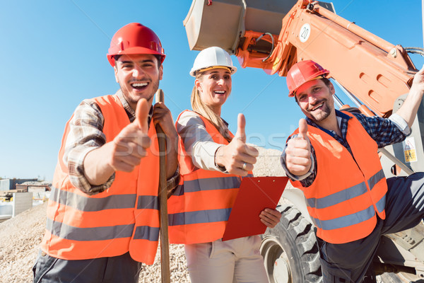 Construction workers and civil engineer showing thumbs up Stock photo © Kzenon