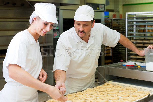 Female and male baker in bakery Stock photo © Kzenon