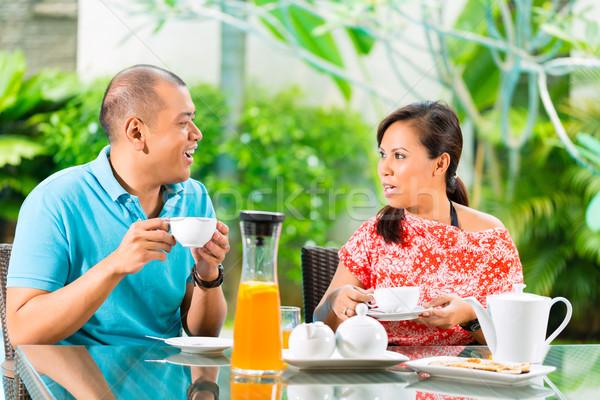 Asiático casal café casa varanda tropical Foto stock © Kzenon