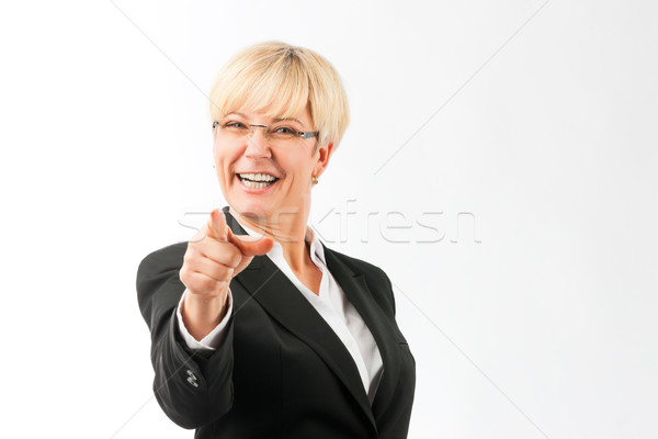 Mature woman point finger on the viewer Stock photo © Kzenon