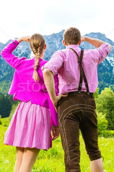 Happy couple in Alpine meadow Stock photo © Kzenon