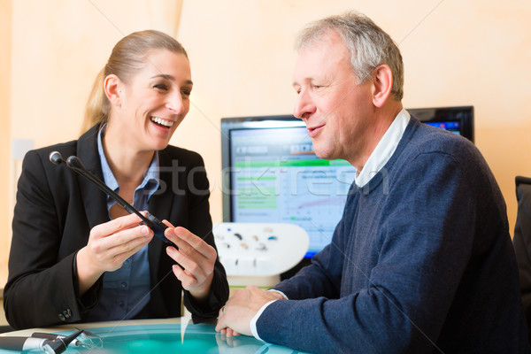 Deaf man makes a hearing test Stock photo © Kzenon