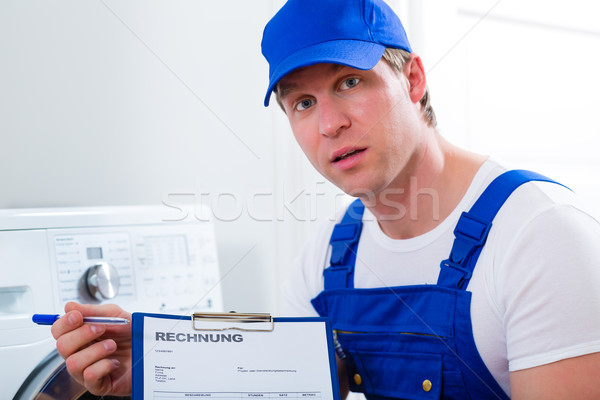 Craftsman or plumber giving overpriced invoice  Stock photo © Kzenon