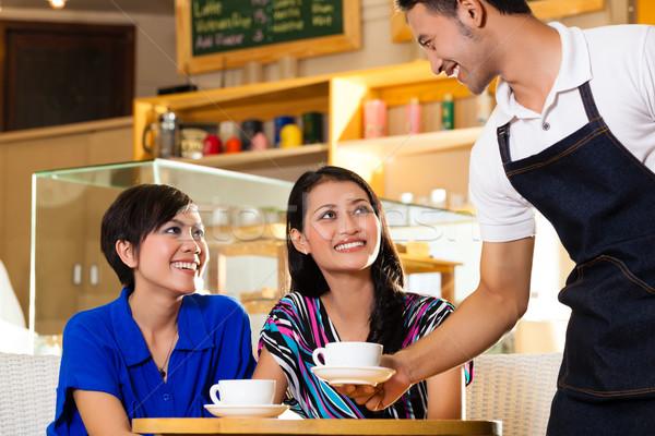 Young women in an Asian coffeeshop Stock photo © Kzenon