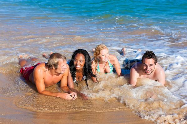 Amis plage vacances groupe quatre hommes Photo stock © Kzenon
