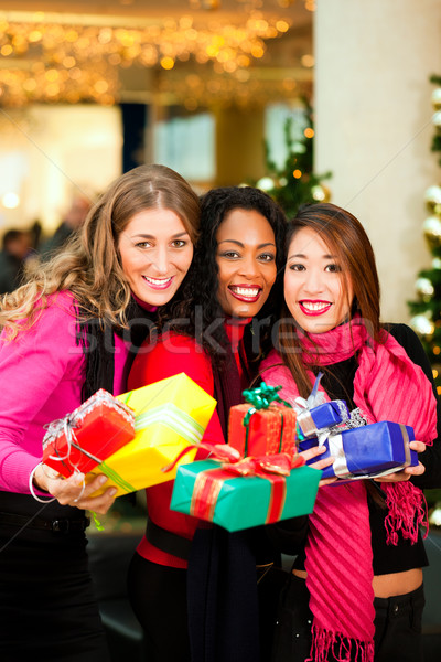 Friends Christmas shopping with presents in mall Stock photo © Kzenon
