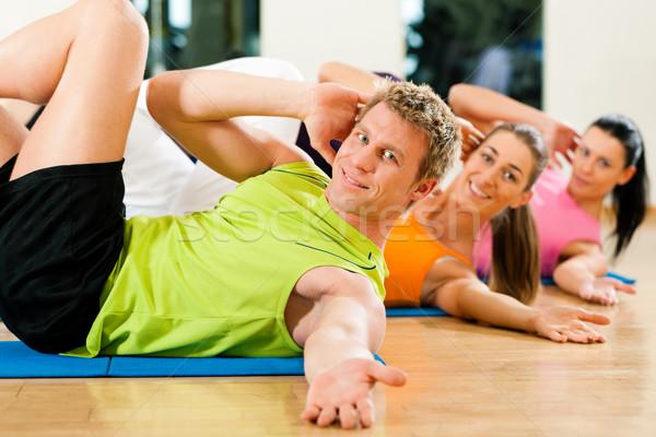 Sit-ups in gym for fitness Stock photo © Kzenon
