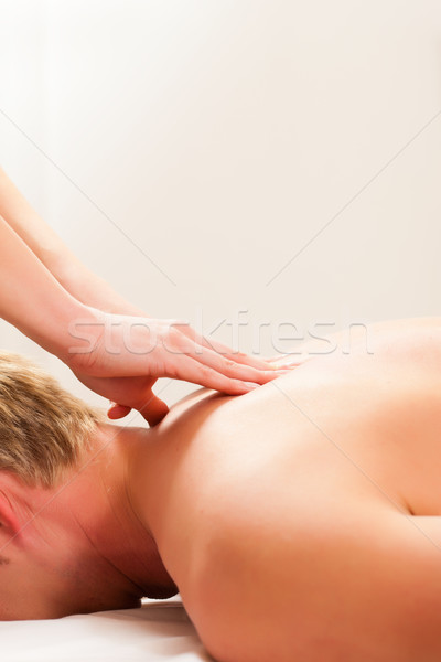 Patient at the physiotherapy - massage Stock photo © Kzenon