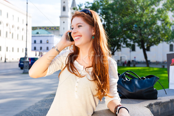 Young Woman calls with mobile phone in the Park Stock photo © Kzenon