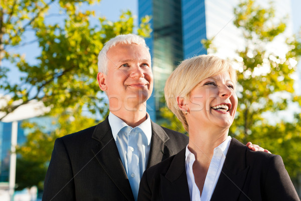 Business people in a park outdoors Stock photo © Kzenon