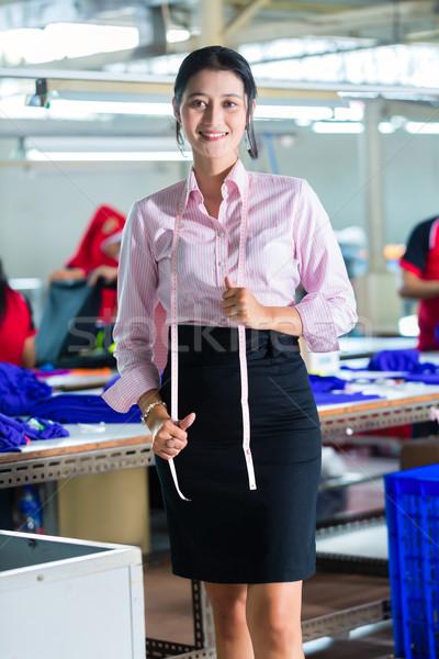 Asian dressmaker in a textile factory Stock photo © Kzenon