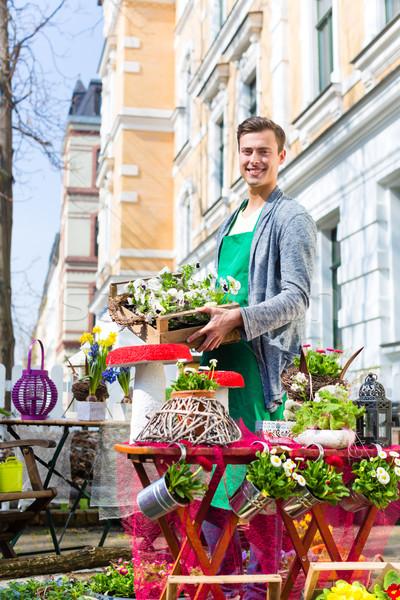 Florist with plant supply at shop Stock photo © Kzenon