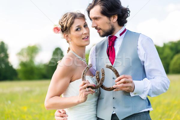 Esküvő pár mutat patkó nő férfi Stock fotó © Kzenon