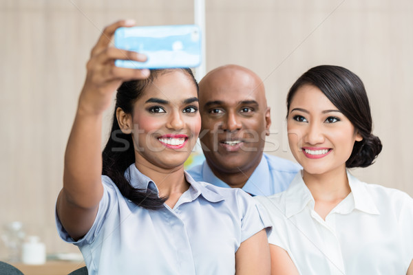 Asian business people taking selfie with phone Stock photo © Kzenon