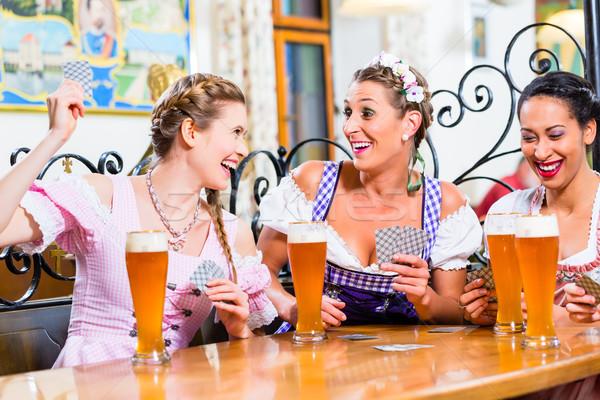 Nők kocsma kártyapakli játék nő sör Stock fotó © Kzenon