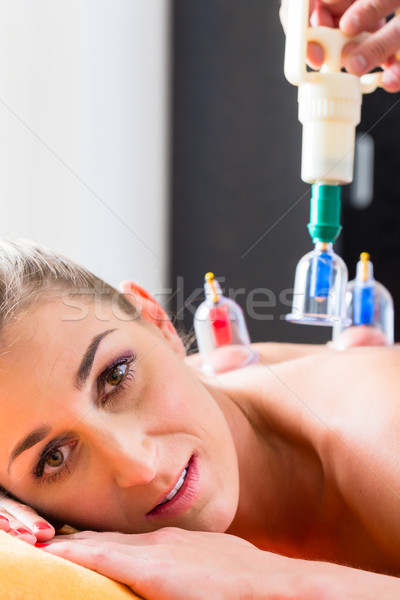Woman in alternative medical cupping therapy Stock photo © Kzenon
