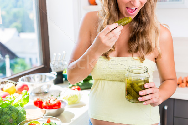 Pregnant woman craving for pickled gherkins Stock photo © Kzenon