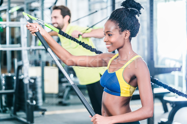 Woman and man in functional training for better fitness Stock photo © Kzenon