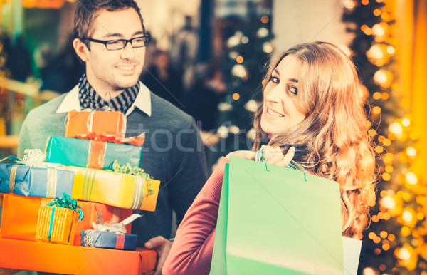 Couple shopping  Christmas presents and bags in mall Stock photo © Kzenon