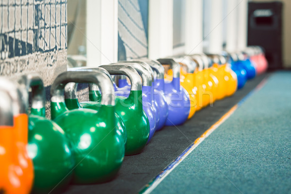 Close-up of kettlebells of various weights and colors Stock photo © Kzenon
