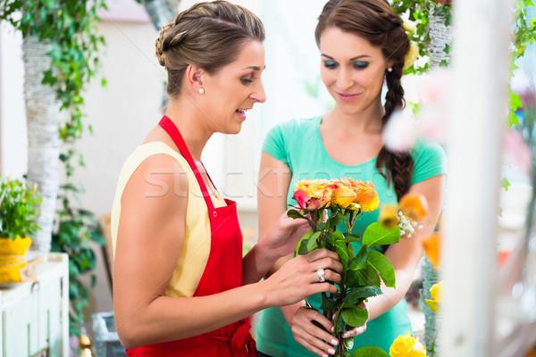 Women in flower store enjoying the roses Stock photo © Kzenon