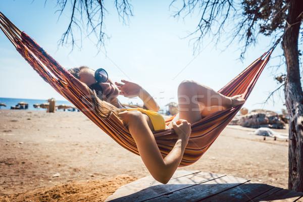 женщину гамак тесные пляж солнце Сток-фото © Kzenon