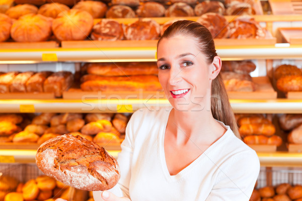 Female baker in her bakery Stock photo © Kzenon