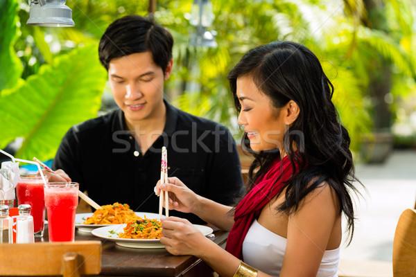 Asian man and woman in restaurant Stock photo © Kzenon