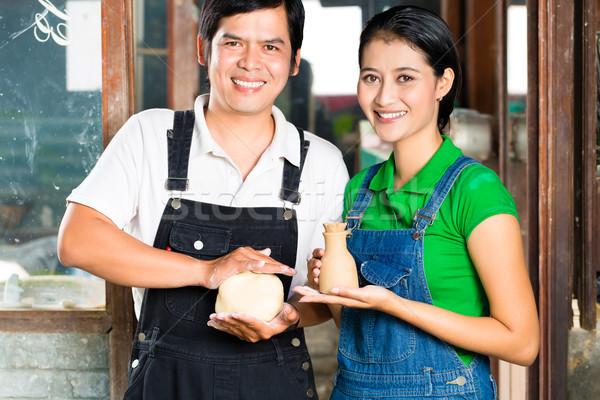 Asians with handmade pottery in clay studio Stock photo © Kzenon