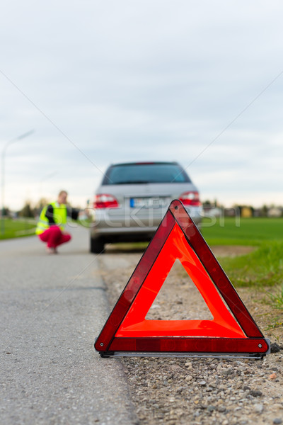 Young woman with warning triangle on street Stock photo © Kzenon