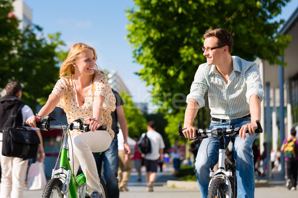 urban couple riding bike in free time in city Stock photo © Kzenon