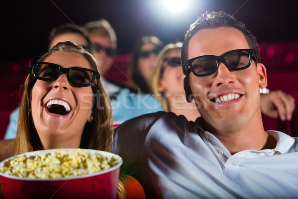 Giovani guardare 3D film teatro sorriso Foto d'archivio © Kzenon