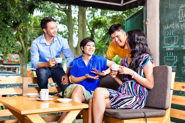 Stock photo: Group of young people in an Asian coffee shop