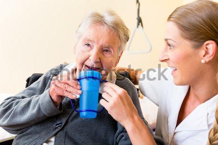 Senior couple drinking red wine Stock photo © Kzenon